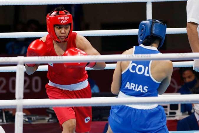 Boxer Nesthy Petecio advances to semis, assured of bronze medal